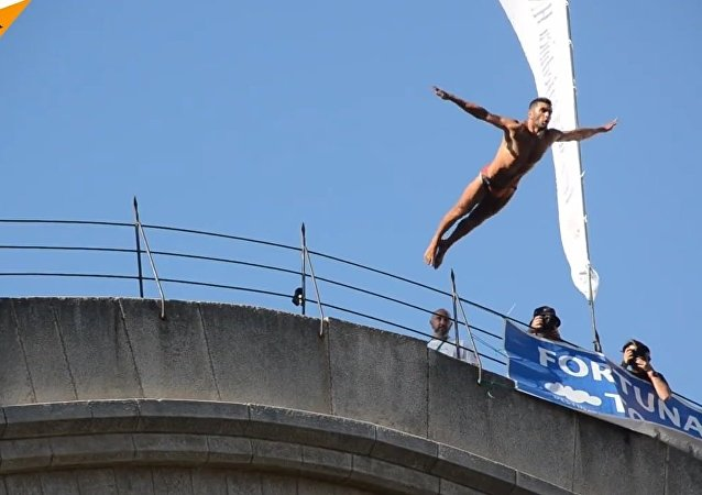 Bridge Jumping In Bosnian Mostar