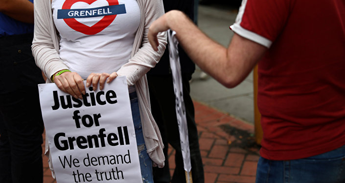 Demonstrators protest against the Grenfell Tower fire outside a Kensington and Chelsea Council meeting at Kensington Town Hall in London, Britain July 19, 2017.