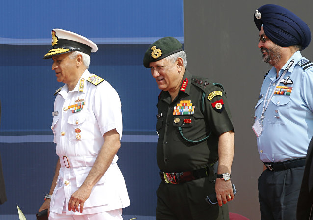 Indian Army Chief Bipin Rawat, center, Air Force Chief Birender Singh Dhanoa, right, and Navy Chief Sunil Lanba arrive at the opening ceremony of Aero India 2017 at Yelahanka air base in Bangalore, India, Tuesday, Feb. 14, 2017