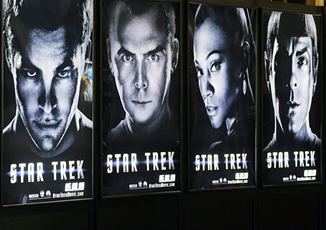 A visitor walks past a line of posters for the forthcoming film Star Trek, on the first day of ShoWest, the largest annual convention for the motion picture industry, Monday, March 30, 2009, in Las Vegas
