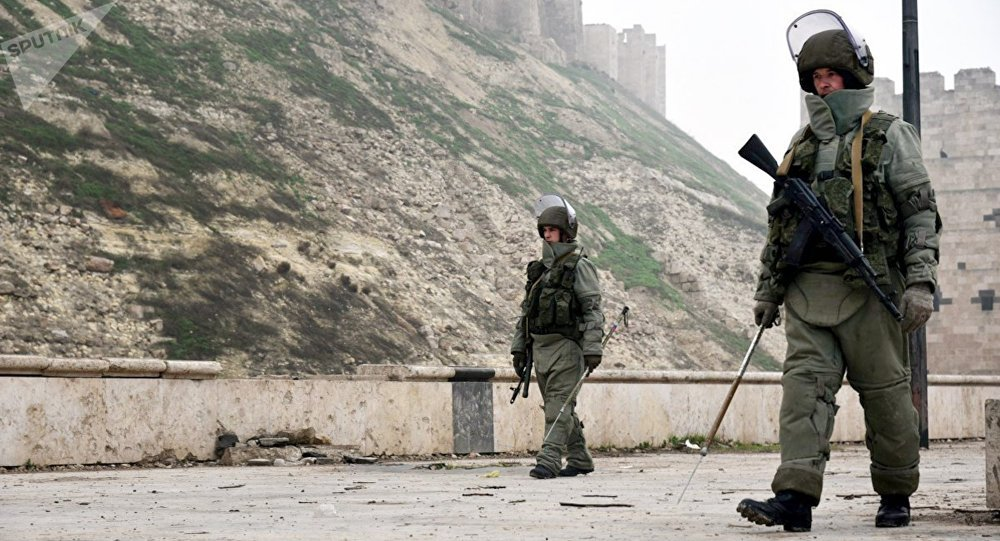 Military personnel during a clearing operation at the medieval Citadel of Aleppo