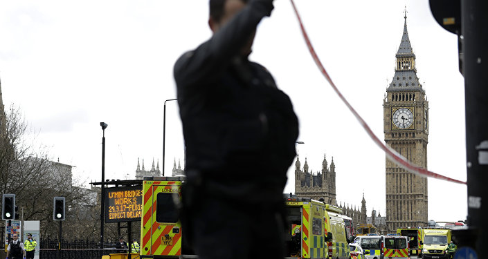 Police secure the area close to the Houses of Parliament in London, Wednesday, March 22, 2017.