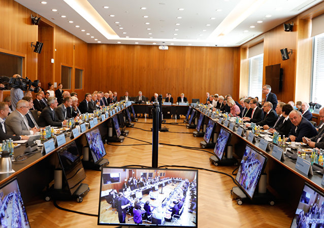 Participants have taken seat to attend a so-called diesel summit on August 2, 2017 in Berlin