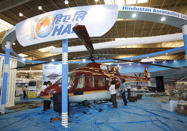 Workers polish a helicopter at the stall of Hindustan Aeronautics Ltd. on the eve of Aero India 2011 at Yelahanka air base on the outskirts of Bangalore, India. (File)
