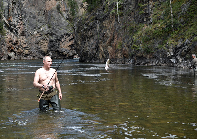 Russian President Vladimir Putin fishing at the cascade of mountain lakes in the Republic of Tyva, during his vacation on August 1-3