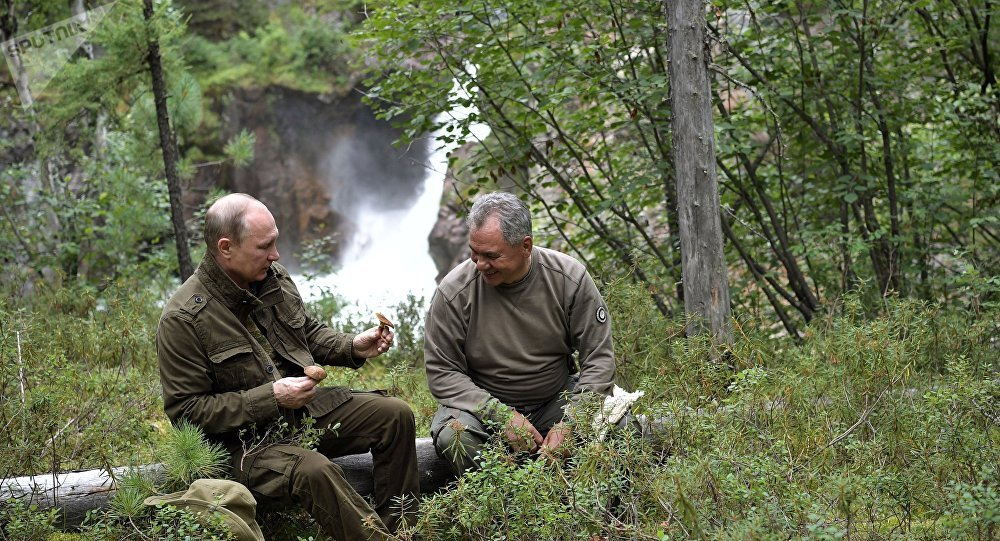 Russian President Vladimir Putin and Russian Defense Minister Sergei Shoigu, right, during trekking in the mountains of the Republic of Tyva, during the President's vacation on August 1-3