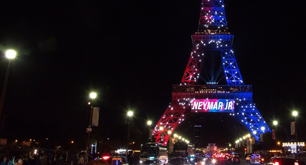 Red and blue lights and a welcoming message that reads in French Neymar Jr. adorn the Eiffel Tower to celebrate the arrival of Brazilian footballer Neymar to Paris on August 5, 2017