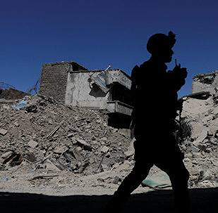 A member of Iraqi federal police patrols in the destroyed Old City of Mosul, Iraq August 7, 2017