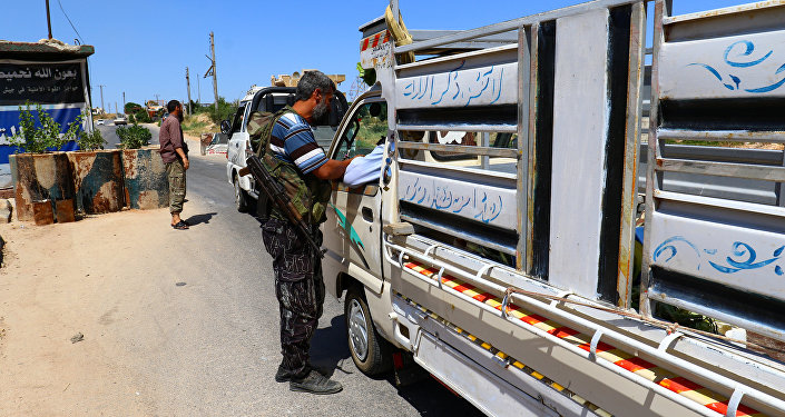 Members from a coalition of rebel groups called Jaish al Fateh, also known as Army of Fatah (Conquest Army), man a checkpoint in Idlib city, Syria July 18, 2017. Picture taken July 18, 2017