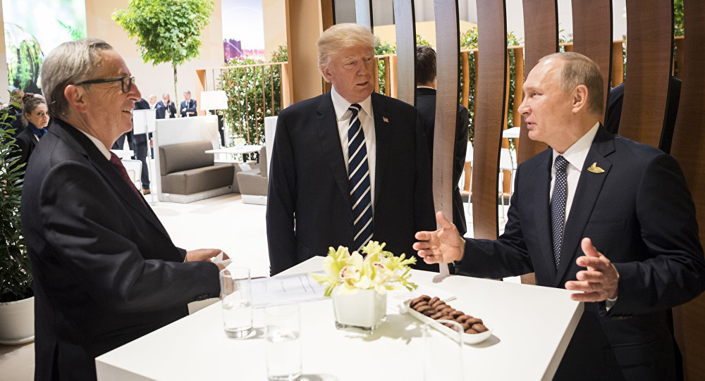 In this photo provided by German government U.S. President Donald Trump, center, talks to Russian President Vladimir Putin and European Commission President Jean-Claude Juncker, left, before the first working session of the G-20 summit in Hamburg, northern Germany.