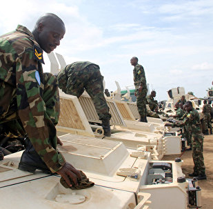 Rwandan peacekeepers from the Rwanda Defence Force (RDF) check their armoured personnel carriers (APC) before a parade in Juba, South Sudan, August 8, 2017