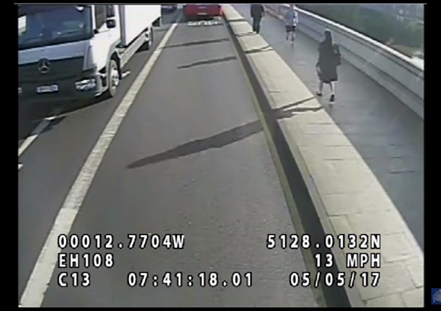 Footage Catches Jogger Pushing Pedestrian in Front of Double-Decker Bus
