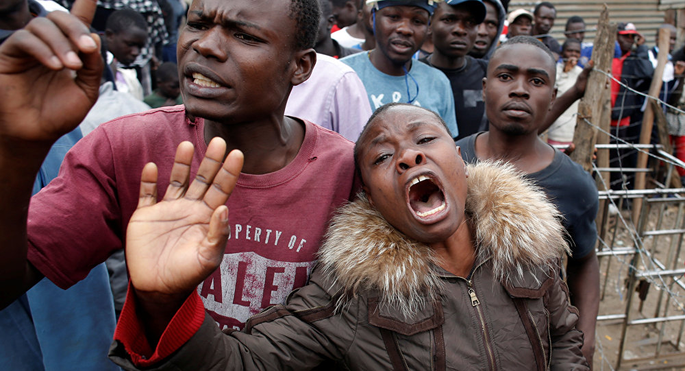 A woman cries after a supporter of opposition leader Raila Odinga was killed by police, witnesses said, in Mathare slum in Nairobi, Kenya August 9, 2017.