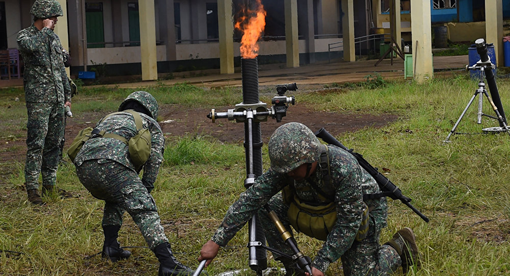 Philippine Marines prepare to fire 81mm mortars at Muslim militant positions at the frontline in Marawi, on the southern island of Mindanao on July 22, 2017