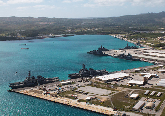 Navy vessels are moored in port at the US Naval Base Guam at Apra Harbor, Guam.