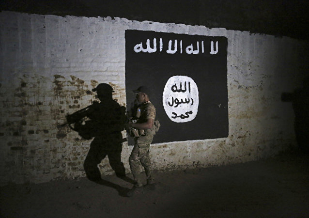 An Iraqi soldier inspects a recently-discovered train tunnel, adorned with an Islamic State group flag, that belonged to the former Baghdad to Mosul line, that was turned it to a training camp for IS fighters, in western Mosul, Iraq, Wednesday, March 1. 2017