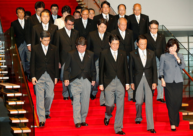 Japan's Prime Minister Shinzo Abe (front C) leads his cabinet ministers as they attend a photo session at Abe's official residence in Tokyo, Japan, August 3, 2017