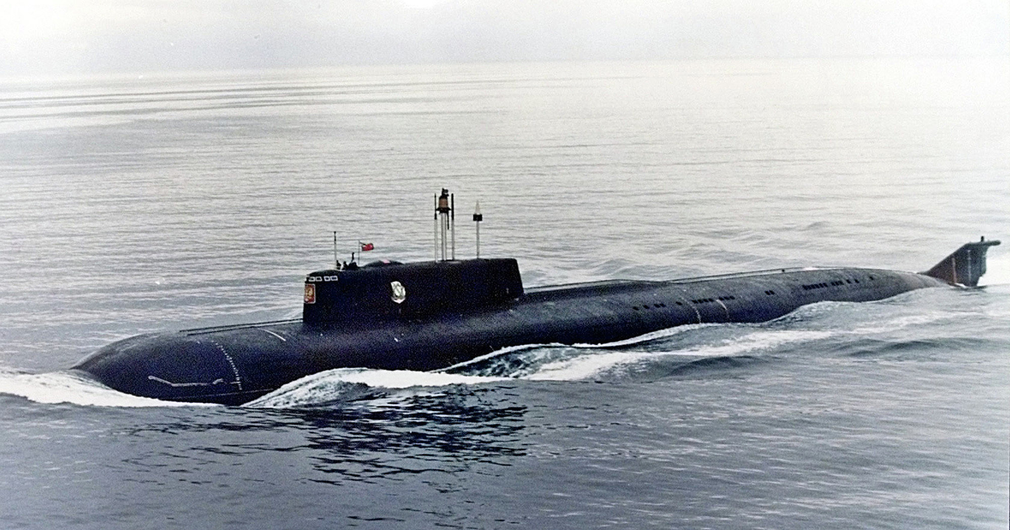 The Kursk, one of Russia's largest and most advanced submarines, which exploded and sank during naval maneuvers in August 2000, heaves ahead in the Barents Sea near Severomorsk in this 1999 file photo