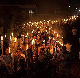 White nationalists carry torches on the grounds of the University of Virginia, on the eve of a planned Unite The Right rally in Charlottesville, Virginia, U.S
