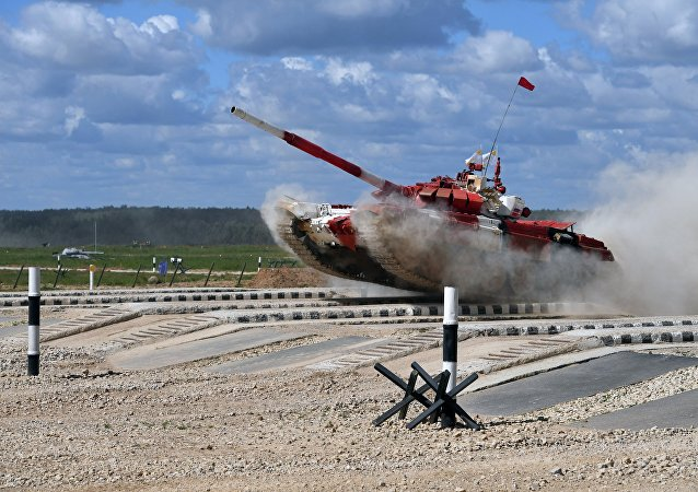 Russian Army's tank crew competes in the semifinal relay race during the tank biathlon competitions of the 2017 International Army Games at the Alabino training ground near Moscow