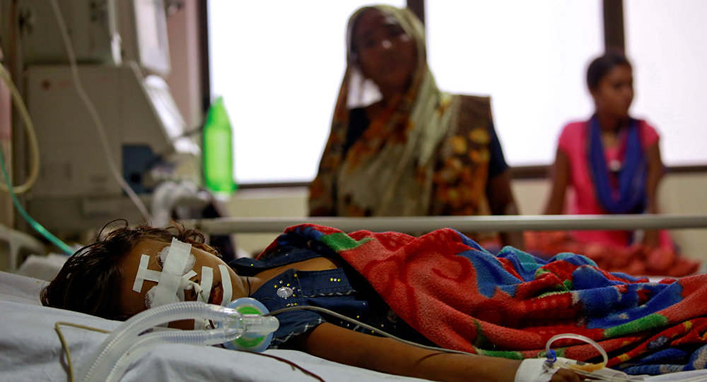 A child is seen in the Intensive care unit in the Baba Raghav Das hospital in Gorakhpur district, India