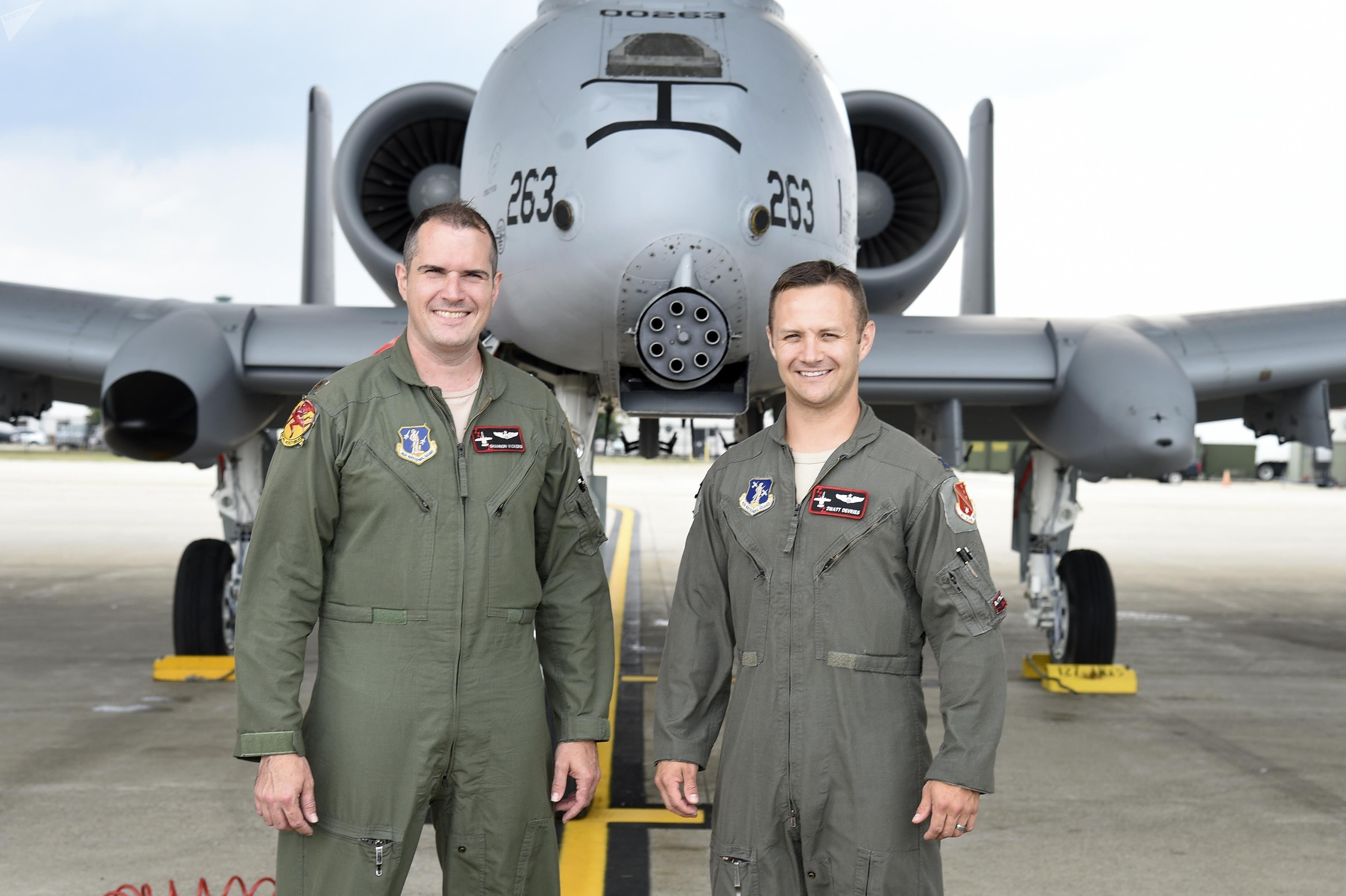 Capt. Brett DeVries (right) and his wingman Maj. Shannon Vickers, both A-10 Thunderbolt II pilots of the 107th Fighter Squadron from Selfridge Air National Guard Base, Mich. Vickers helped DeVries safely make an emergency landing July 20 at the Alpena Combat Readiness Training Center after the A-10 DeVries was flying experienced a malfunction