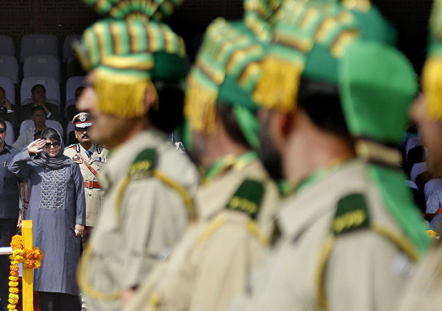 Jammu and Kashmir state Chief Minister Mehbooba Mufti salutes during an Independence Day parade in Srinagar, Indian controlled Kashmir, Tuesday, Aug. 15, 2017.