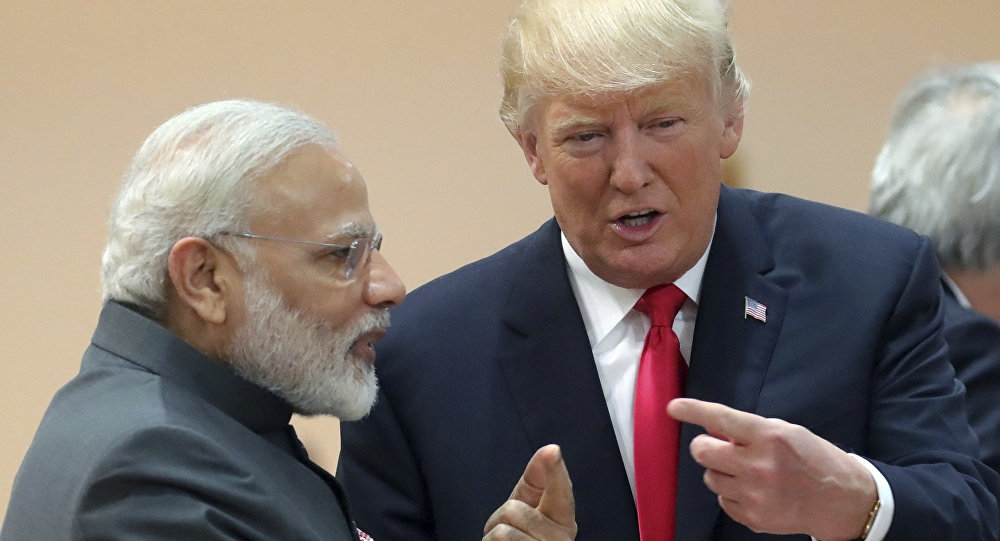 India's Prime Minister Narendra Modi, in conversation with U.S. president Donald Trump during a working session of the G20 summit in Hamburg, Germany, Saturday, July 8, 2017