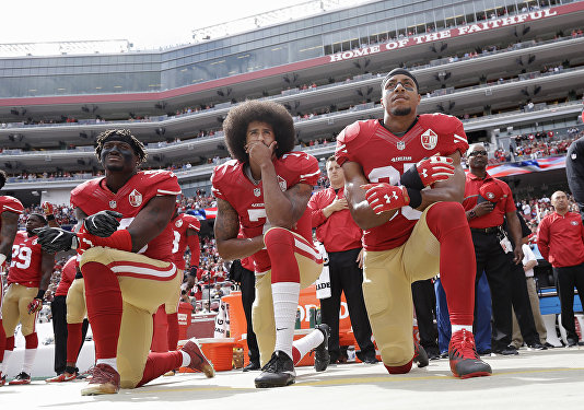 FILE - In this Oct. 2, 2016 file photo, from left, San Francisco 49ers outside linebacker Eli Harold, quarterback Colin Kaepernick and safety Eric Reid kneel during the national anthem before an NFL football game against the Dallas Cowboys in Santa Clara, Calif. In recent months, Colin Kaepernick has become comfortable with people knowing him as more than a laser-focused football player as he always previously preferred it. Perhaps, through the anthem protest and his emergence as an outspoken activist for minorities, Kaepernick has improved his image in the process.