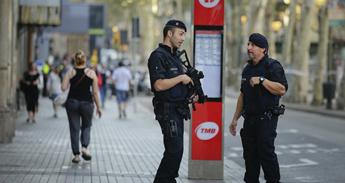 Armed police officers patrol a street in Las Ramblas, Barcelona, Spain, Friday, Aug. 18, 2017