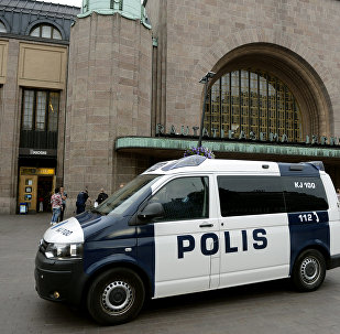 Finnish police patrol in front of the Central Railway Station