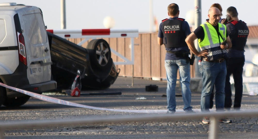 Police investigate at the scene of an attack in Cambrils, south of Barcelona, Spain