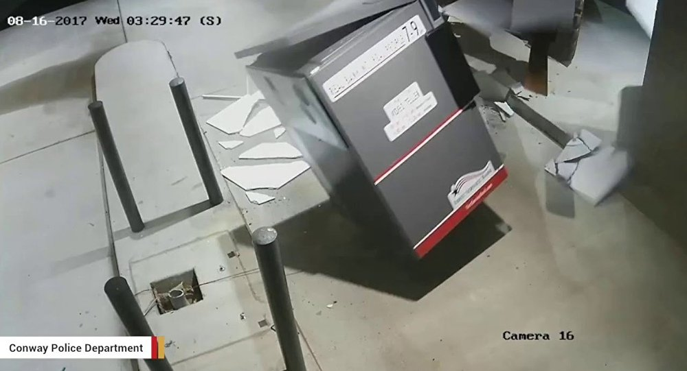 Screenshot of surveillance footage shows thieves using a forklift to steal an ATM in Arkansas.