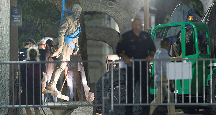 Workers remove Confederate General Robert E. Lee statue from the south mall of the University of Texas in Austin, Texas, U.S