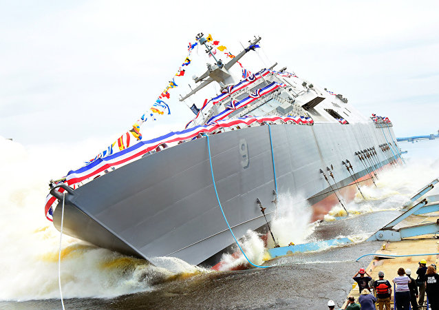 The U.S.Navy littoral combat ship USS Little Rock (LCS-9) is launched into the Menominee River in Marinette, Wisconsin (USA), on 18 July 2015