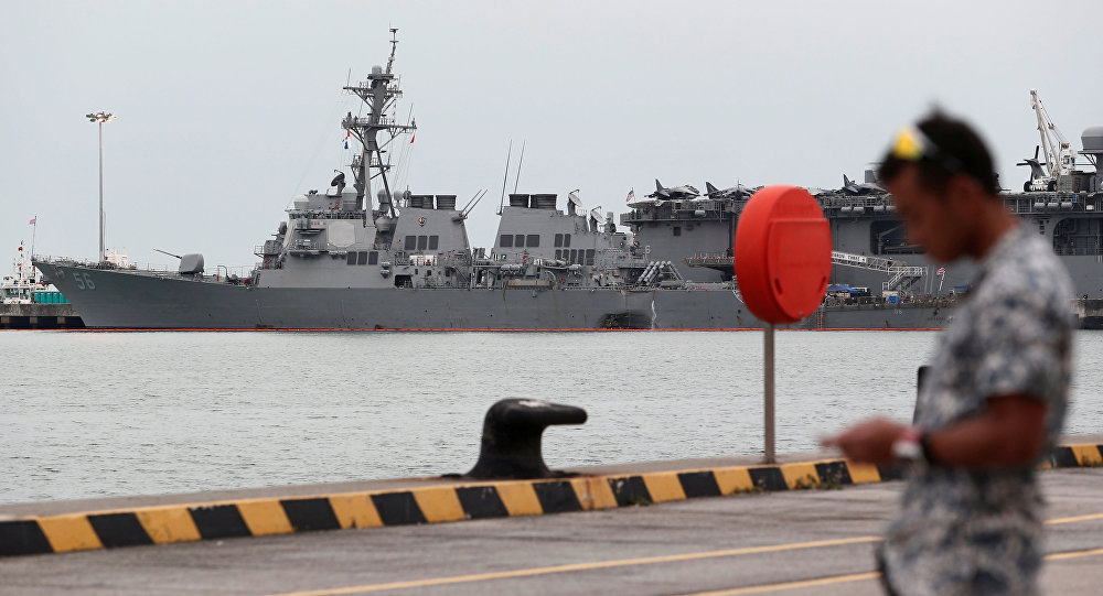 The damaged USS John McCain and the USS America are docked at Changi Naval Base in Singapore August 22, 2017