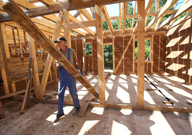 Construction of wooden houses. File photo