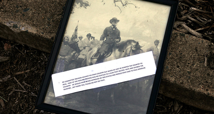 A framed picture of Confederate General Robert E. Lee, with an inscription, is placed by someone in the park formerly dedicated to him and the site of recent violent demonstrations in Charlottesville, Virginia, U.S. August 18, 2017