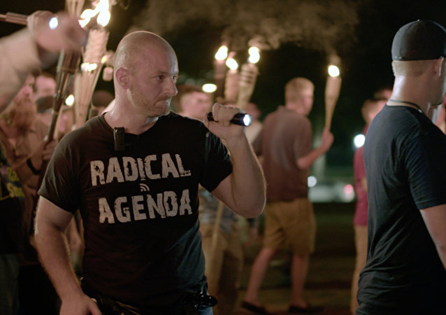 Aug. 11, 2017, image made from a video provided by Vice News Tonight, Christopher Cantwell attends a white nationalist rally in Charlottesville, Va