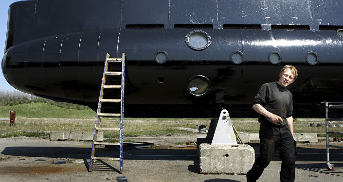 This April 30, 2008 file photo, shows a submarine and its owner Peter Madsen.