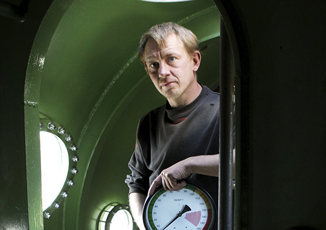 In this April 30, 2008 file photo, submarine owner Peter Madsen stands inside the vessel.
