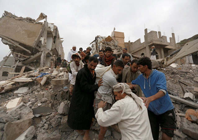 People carry the body of a woman they recovered from under the rubble of a house destroyed by a Saudi-led air strike in Sanaa, Yemen August 25, 2017