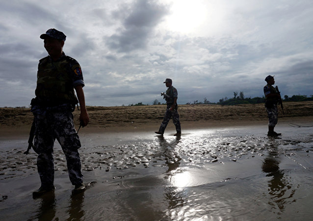A Myanmar border guard police officers stand guard in Buthidaung, northern Rakhine state, Myanmar (File)