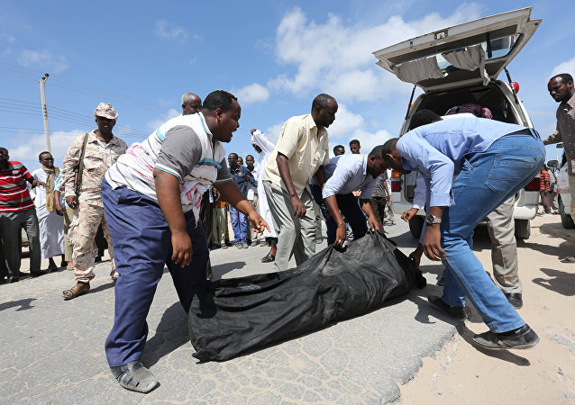Relatives carry the body of a farmer killed in an attack by Somali forces and supported by U.S. troops in lower Shebelle Region, Somalia, August 25, 2017