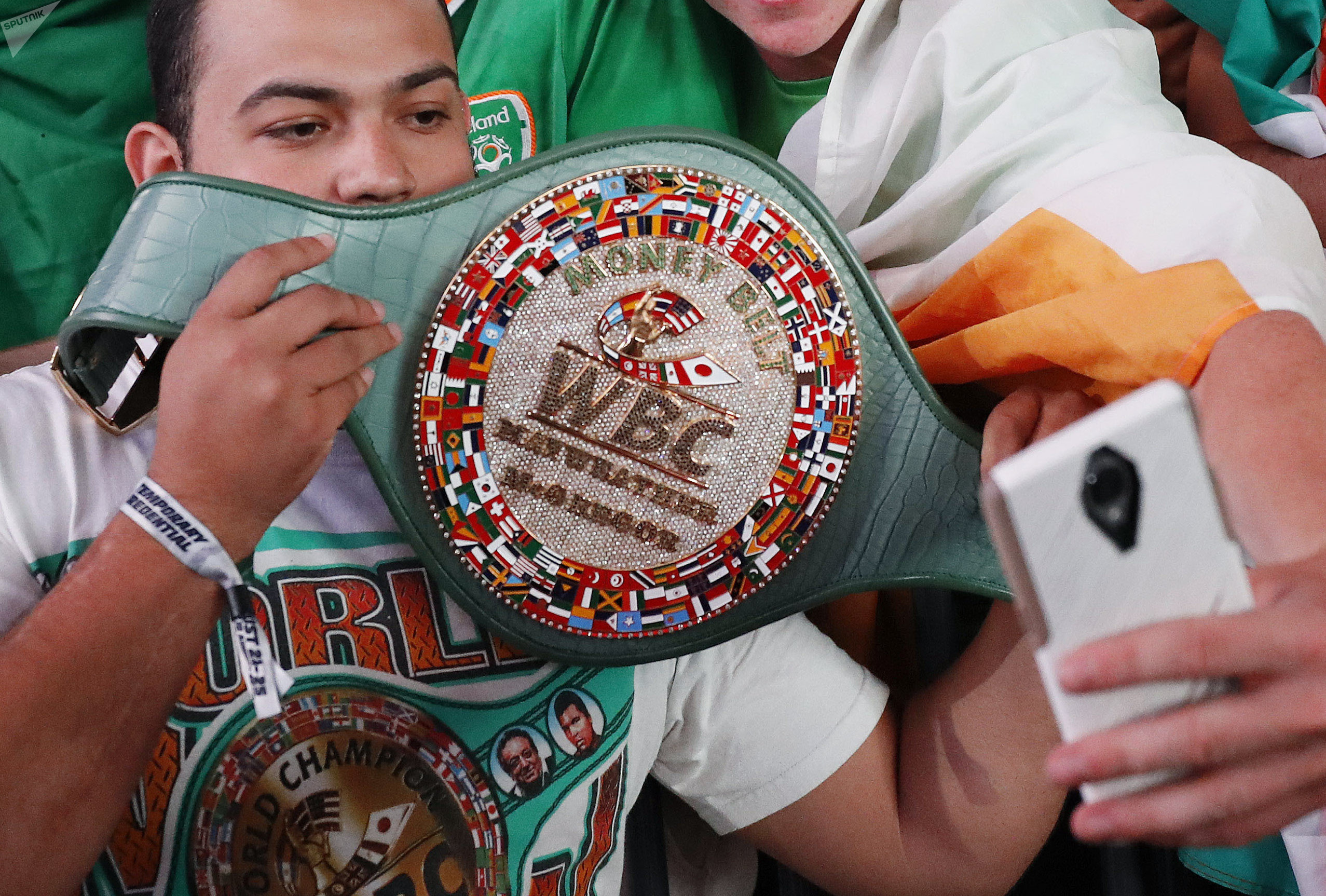 Fans take selfies with the WBC money belt before a weigh-in Friday, Aug. 25, 2017, in Las Vegas.
