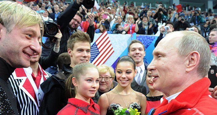 February 9, 2014. Russian President Vladimir Putin congratulates Russian athletes during a visit to a figure skating competition at the XXII Olympic Winter Games in Sochi. From left: Evgeni Plushenko, Yulia Lipnitskaya, Nikita Katsalapov and Yelena Ilyinykh.