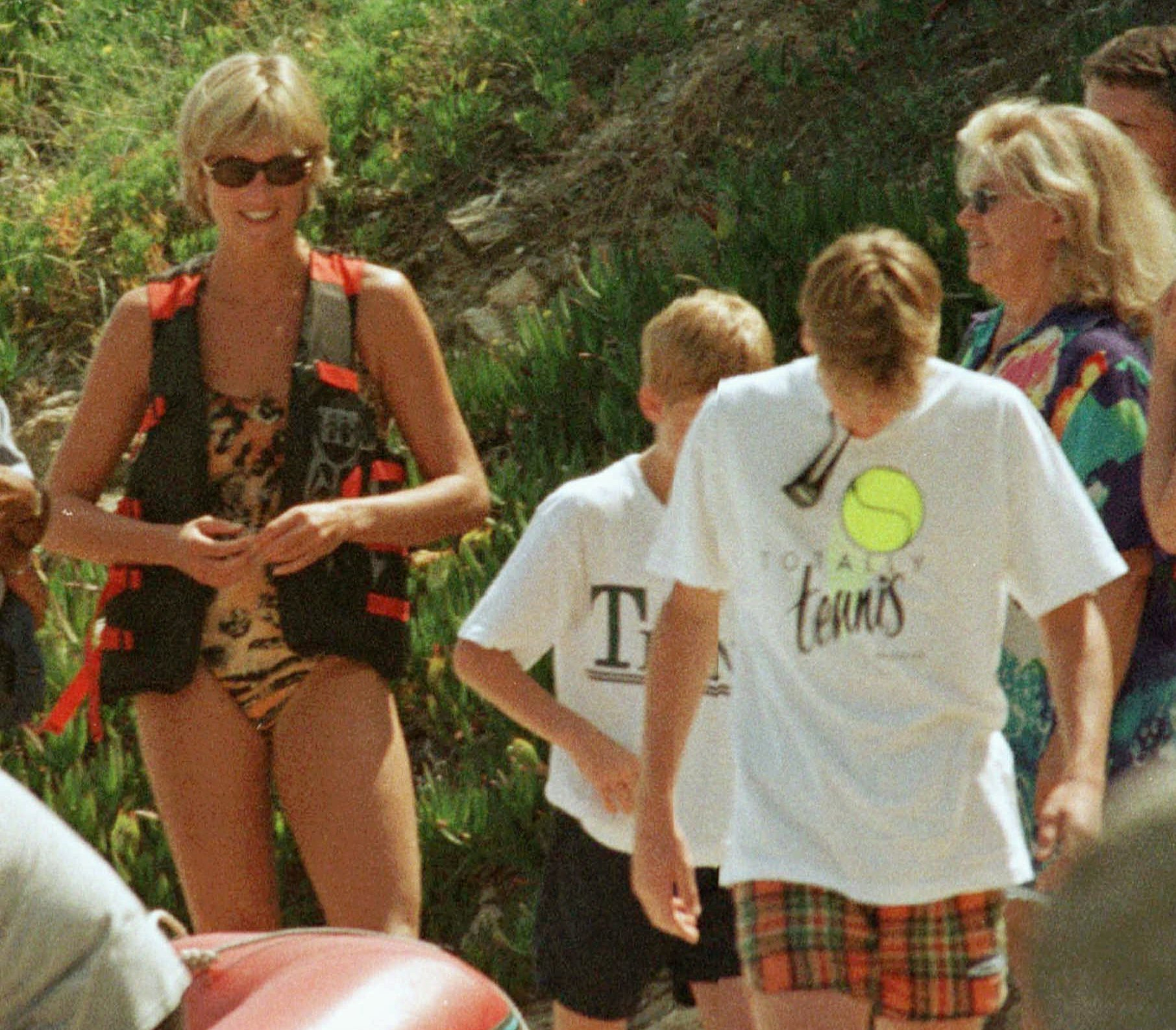 Britain's Princess Diana looks at her two sons Prince William, right, and Prince Harry, at Saint Tropez, on the French Riviera, Monday July 14, 1997, where she is spending a few days vacationing and staying at the residence of Egyptian businessman Mohamed Al Fayed.