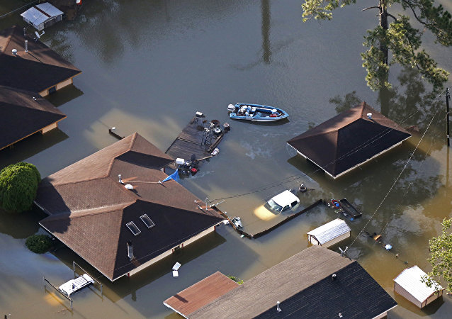 A boat sits near flooded homes in the aftermath of Tropical Storm Harvey in Beaumont, Texas, Thursday, Aug. 31, 2017.