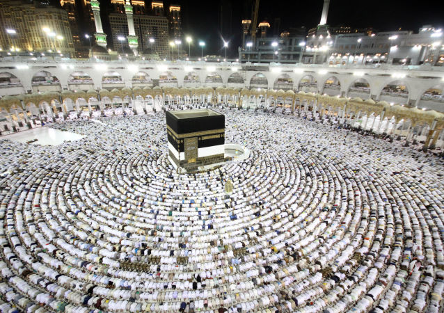 Muslim worshippers perform the evening (Isha) prayers at the Kaaba, Islam's holiest shrine, at the Grand Mosque in Saudi Arabia's holy city of Mecca on August 25, 2017, a week prior to the start of the annual Hajj pilgrimage in the holy city