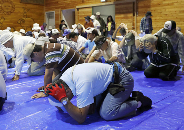 Local residents take part in an emergency drill in the wake of repeated missile launches by North Korea, in Takikawa on Japan's northernmost main island of Hokkaido, in this photo taken by Kyodo September 1, 2017